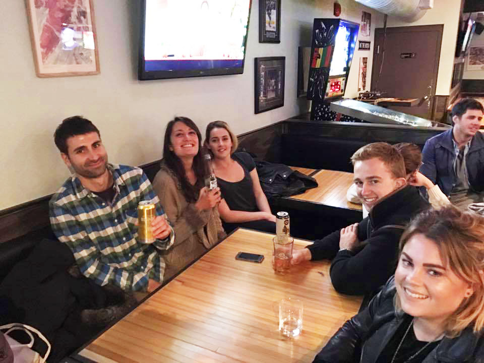 Young people happy drinking in a bar